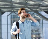Handsome young man talking on cell phone Royalty Free Stock Photography