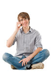 Handsome young man talking by mobile phone Stock Photo