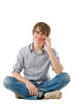 Handsome young man talking by mobile phone Royalty Free Stock Images