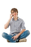 Handsome young man talking by mobile phone Royalty Free Stock Photos
