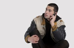 Handsome young man talking on mobile phone Stock Photography