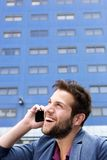 Handsome young man talking on mobile phone Stock Photo