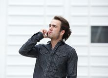 Handsome young man talking on mobile phone Stock Image