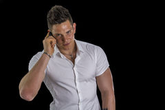 Handsome young man talking on mobile phone Royalty Free Stock Photo