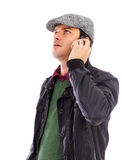 Handsome young man talking on phone Stock Image