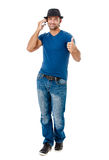 Handsome young man talking on the phone Stock Images