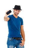 Handsome young man talking on the phone Stock Photos