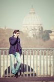 Handsome young man talking on the phone in the city. Rome Italy. Royalty Free Stock Image
