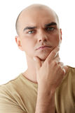Handsome young man thinking Royalty Free Stock Images
