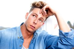 Handsome young man thinking Royalty Free Stock Photo