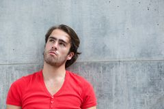 Handsome young man thinking Royalty Free Stock Image