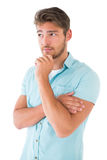 Handsome young man thinking with hand on chin Royalty Free Stock Photography