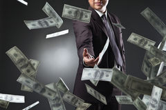 Handsome young man throwing money Royalty Free Stock Images