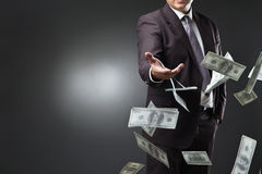 Handsome young man throwing money Royalty Free Stock Photos
