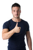 Handsome young man with thumb up doing OK sign Stock Image