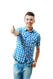 Handsome young man with thumbs up. On an isolated white background Royalty Free Stock Photography