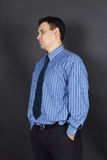 Handsome young man in tie and blue shirt Royalty Free Stock Photography