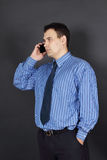 Handsome young man in tie and blue shirt Stock Photos
