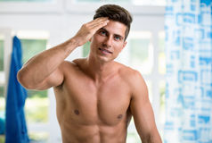 Handsome young man touching his hair Royalty Free Stock Images