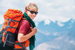 Handsome young man tourist backpacker portrait on Himalaya mount Stock Photos