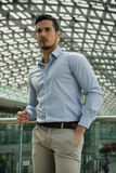 Handsome young man in train station or airport Royalty Free Stock Photography