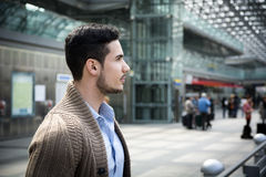 Handsome young man in train station or airport Royalty Free Stock Image