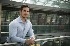 Handsome young man in train station or airport Stock Photos