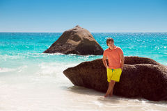 Handsome young man on a tropical beach, relax on summer vacation Royalty Free Stock Photos