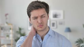 Handsome Young Man Trying to Relax Neck Pain. 4k high quality, 4k high quality stock video footage
