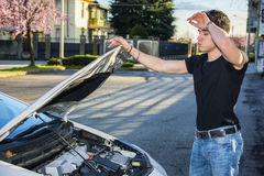 Handsome young man trying to repair a car engine Royalty Free Stock Image