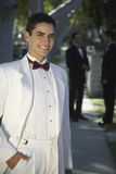 Handsome Young Man In Tuxedo Smiling at Quinceanera Royalty Free Stock Photography