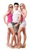Handsome young man and two girls. Isolated Stock Images