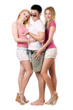 Handsome young man and two pretty girls Royalty Free Stock Image