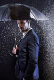 Handsome young man with an umbrella Stock Photo