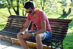 Handsome young man using his mobile phone in the street. Stock Photo