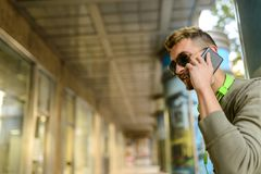 Handsome young man using his phone outdoors stock images