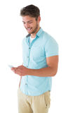 Handsome young man using his smartphone Royalty Free Stock Image