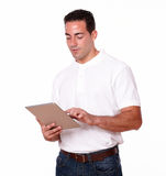 Handsome young man using his tablet pc Stock Images