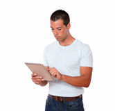 Handsome young man using his tablet pc Royalty Free Stock Photos