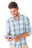 Handsome young man using his tablet pc Stock Photography