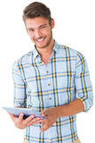 Handsome young man using his tablet pc Stock Photo