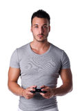 Handsome young man using joystick or joypad for videogames. Attractive young man using joystick or joypad for videogames, isolated on white Royalty Free Stock Photo