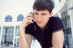 Handsome young man  using a mobile phone Stock Photography