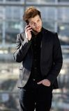 Handsome young man using mobile phone in the city Royalty Free Stock Image