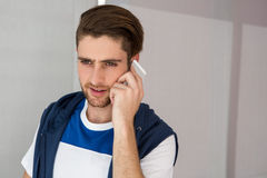 Handsome young man using mobile phone Stock Image