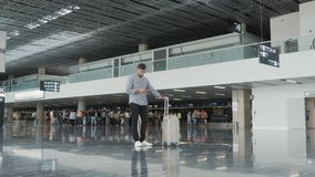 Handsome Young Man Using Smartphone And Working at The Airport While Waiting His Queue For Registration, Travelling. Concept, Technology, 4K stock footage
