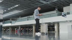Handsome Young Man Using Smartphone And Working at The Airport While Waiting His Queue For Registration, Travelling. Concept, Technology, 4K stock video