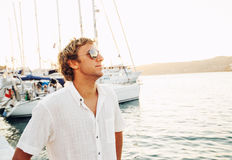 Handsome Young Man on Vacation at Sunset Stock Photo