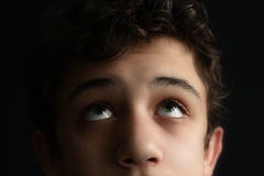 Handsome young man with a view to the height. Portrait of beautiful young man isolated on dark background Stock Photography