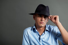 Handsome young man wearing big hat Stock Photography